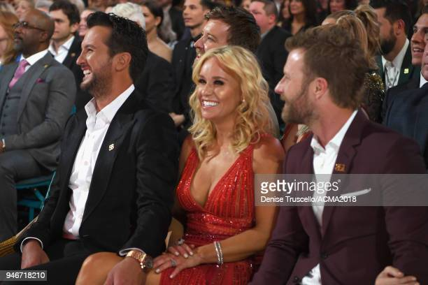 Luke Bryan Caroline Boyer and Dierks Bentley attend the 53rd Academy of Country Music Awards at MGM Grand Garden Arena on April 15 2018 in Las Vegas...