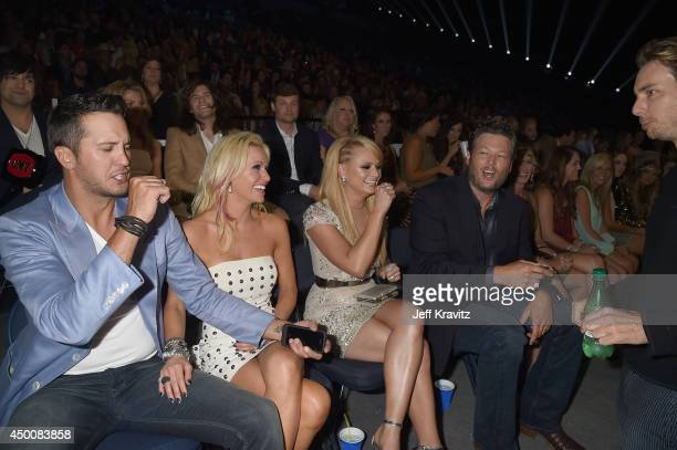 Luke Bryan Caroline Bryan Miranda Lambert Blake Shelton attend the 2014 CMT Music awards at the Bridgestone Arena on June 4 2014 in Nashville...