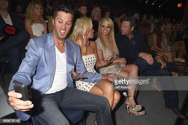 Luke Bryan Caroline Bryan Miranda Lambert Blake Shelton attend the 2014 CMT Music awards at the Bridgestone Arena on June 4 2014 in Nashville...