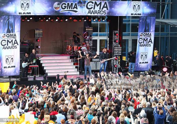 Luke Bryan performs on ABC's Good Morning America outside of the Bridgestone Arena ahead of the CMA Awards on November 6 2013 in Nashville Tennessee