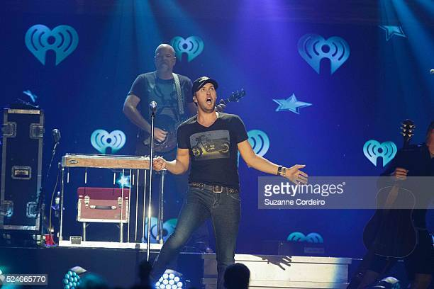 Luke Bryan performs onstage during iHeartRadio Country Festival in Austin at the Frank Erwin Center on March 29 2014 in Austin Texas
