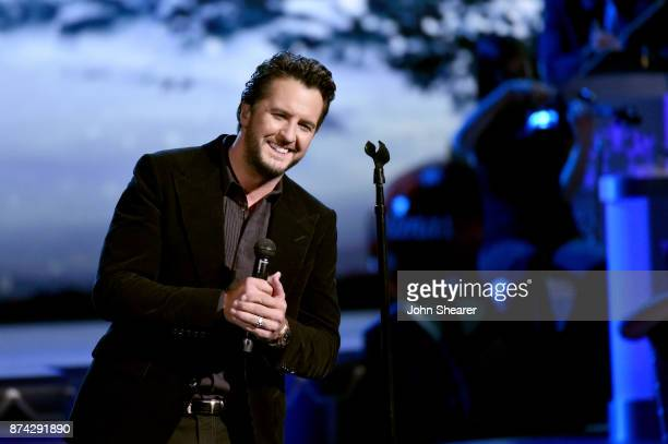 Luke Bryan performs onstage for CMA 2017 Country Christmas at The Grand Ole Opry on November 14 2017 in Nashville Tennessee