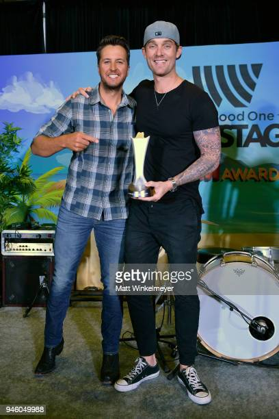 Luke Bryan presents Brett Young with the New Male Vocalist of the Year trophy during the 53rd Academy of Country Music Awards Cumulus/Westwood One...