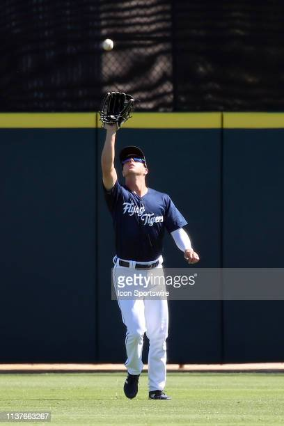 Luke Burch of the Flying Tigers catches a fly ball in the outfield during the Florida State League game between the Palm Beach Cardinals and the...