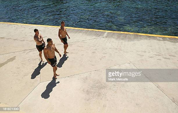 Luke Burgess Ben Te'o and Sam Burgess walk alongside the ocean during a South Sydney Rabbitohs NRL recovery session at Clovelly Beach on September 23...