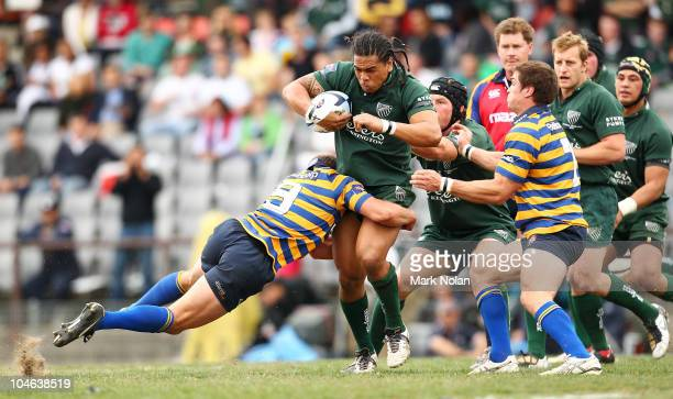 Luke Burgess of Sydney Uni tackles John Tamanika of Randwick during the Shute Shield Grand Final match between Randwick and Sydney University at...