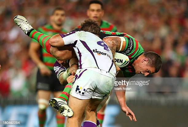 Luke Burgess of the Rabbitohs is tackled during the NRL Qualifying match between the South Sydney Rabbitohs and the Melbourne Storm at ANZ Stadium on...