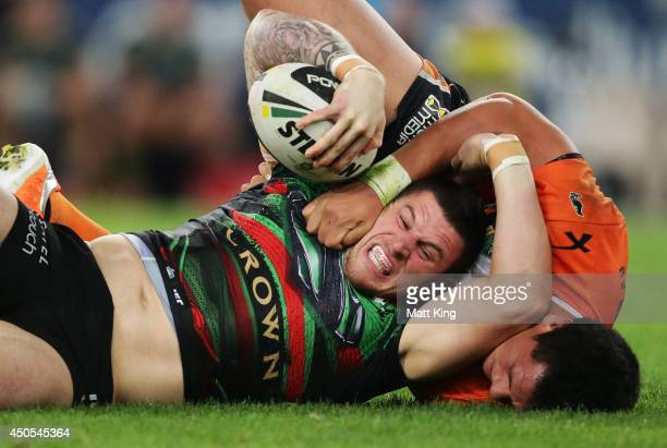 Luke Burgess of the Rabbitohs is tackled during the round 14 NRL match between the South Sydney Rabbitohs and the Wests Tigers at ANZ Stadium on June...