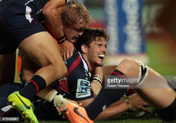 Luke Burgess of the Rebels crosses the line to score a try during the round three Super Rugby match between the Melbourne Rebels and the Cheetahs at...