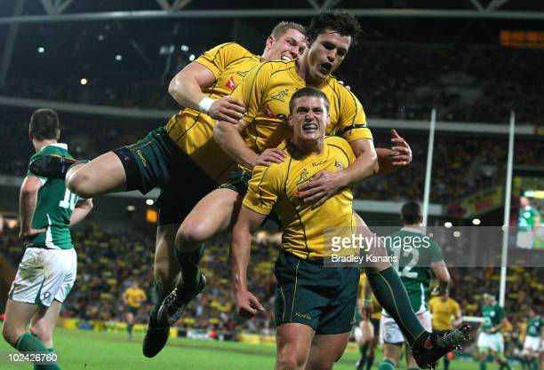 Luke Burgess of the Wallabies celebrates with team mates after scoring a try during the Lansdowne Cup Test Match between the Australian Wallabies and...