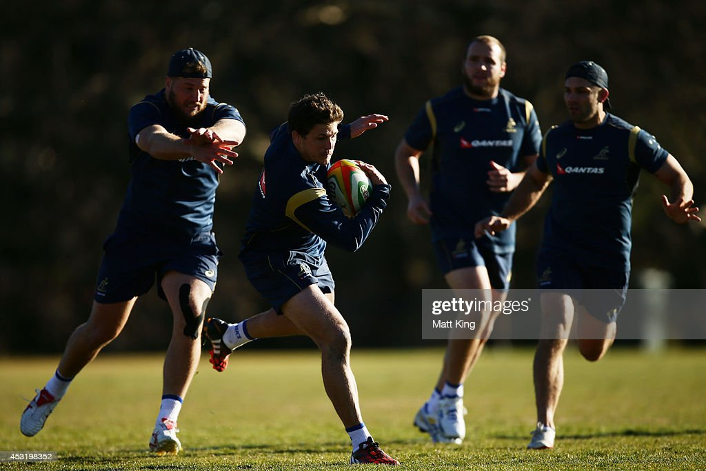 Luke Burgess of the Wallabies runs with the ball during an Australian Wallabies training session at Kinross Wolaroi School on August 5, 2014 in Orange, Australia.