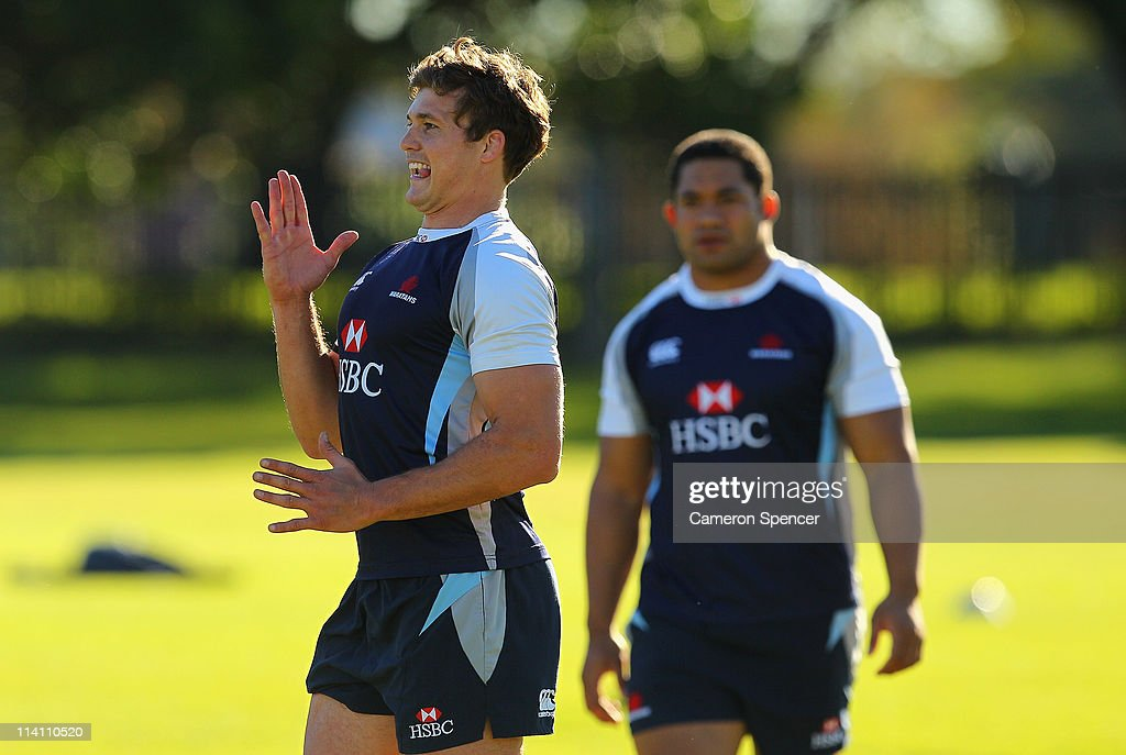 Luke Burgess of the Waratahs jokes with team mates during a Waratahs Super Rugby training session at Moore Park on May 12, 2011 in Sydney, Australia.