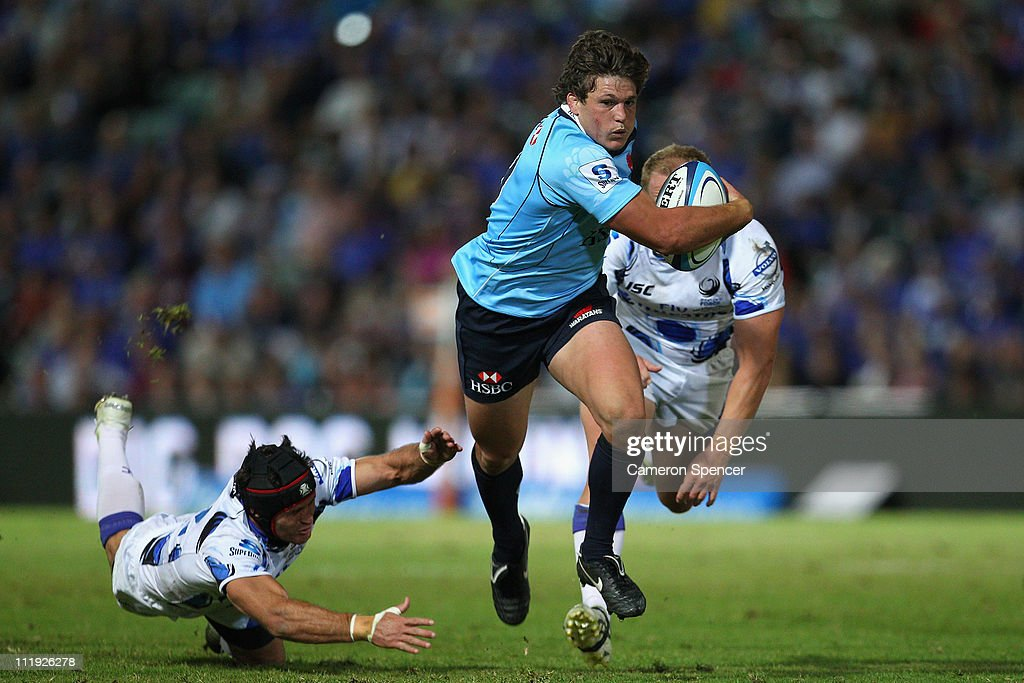 Luke Burgess of the Waratahs makes a break during the round eight Super Rugby match between the Western Force and the Waratahs at NIB Stadium on April 9, 2011 in Perth, Australia.