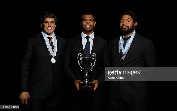 Luke Burgess poses with the best back award Kurtley Beale poses with the Matthew Burke Cup awarded for the Waratahs player's player and Tatafu...