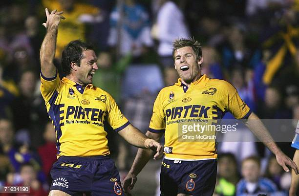 Luke Burt of the Eels celebrates with team mate Glenn Morrison after scoring a try during the round 23 NRL match between the CronullaSutherland...