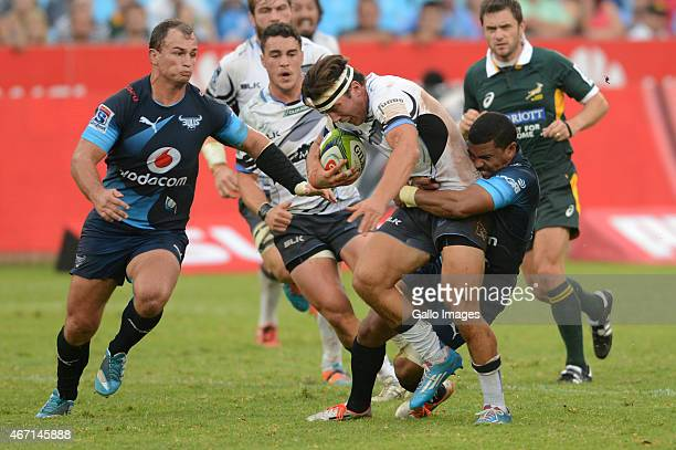 Luke Burton of the Western Force tackled by Rudy Paige of the Bulls during the Super Rugby match between Vodacom Bulls and Force at Loftus Versfeld...
