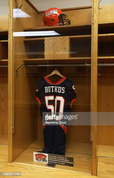 Luke Butkus' retired University of Illinois football jersey hangs in the visiting team locker room at Soldier Field, home of the Chicago Bears...