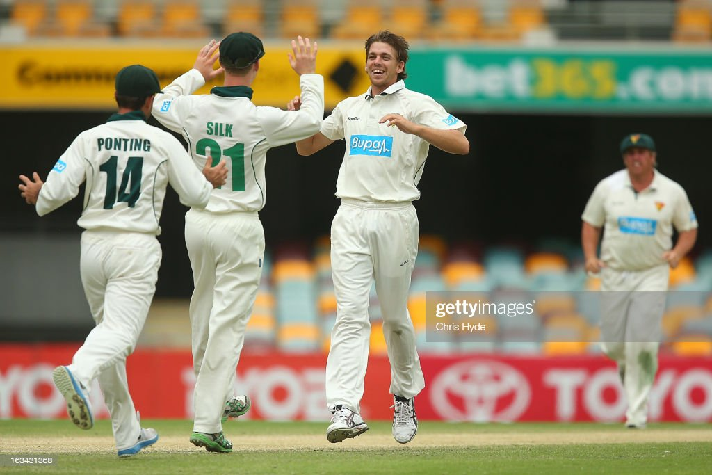 Luke Butterworth of the Tigers celebrates with team mates after dismissing Greg Moller of the Bulls during day four of the Sheffield Shield match between the Queensland Bulls and the Tasmanian Tigers at The Gabba on March 10, 2013 in Brisbane, Australia.