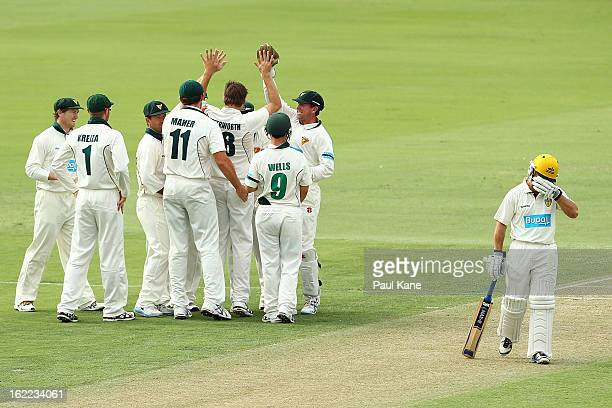 Luke Butterworth of the Tigers is congratulated by team mates after dismissing Liam Davis of the Warriors during day one of Sheffield Shield match...