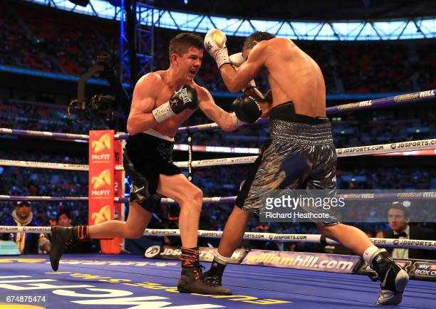 Luke Campbel and Darleys Perez in action during the WBA Leightweight Eliminator bout at Wembley Stadium on April 29 2017 in London England
