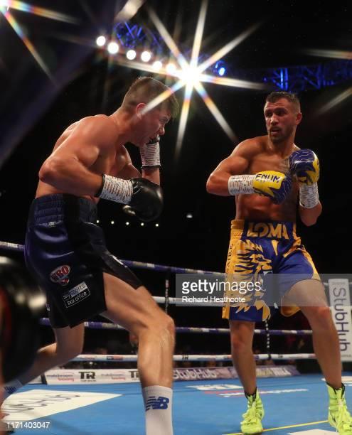 Luke Campbell amd Vasily Lomachenko are pictured during the WBA, WBO, WBC Lightweight World Title contest between Vasily Lomachenko and Luke Campbell...