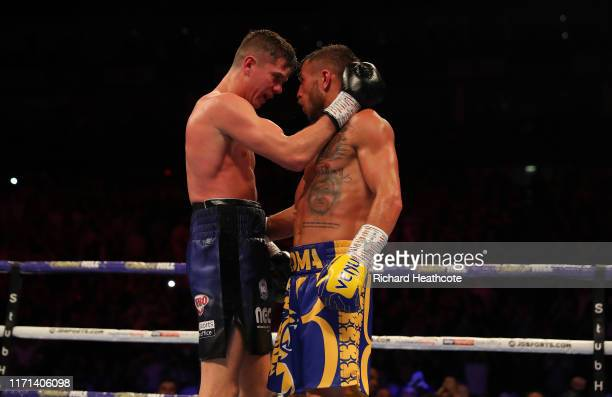 Luke Campbell amd Vasily Lomachenko embrace at the end of their fight during the WBA, WBO, WBC Lightweight World Title contest between Vasily...