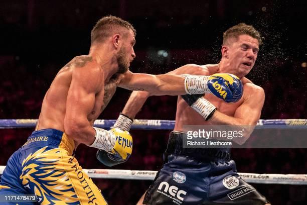 Luke Campbell and Vasily Lomachenko are pictured during the WBA, WBO, WBC Lightweight World Title contest between Vasily Lomachenko and Luke Campbell...