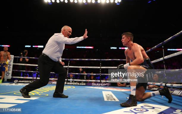 Luke Campbell is given a count fom the referee during the WBA, WBO, WBC Lightweight World Title contest between Vasily Lomachenko and Luke Campbell...