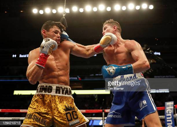 Luke Campbell lands a right hook against Ryan Garcia during the WBC Interim Lightweight Title fight at American Airlines Center on January 02, 2021...