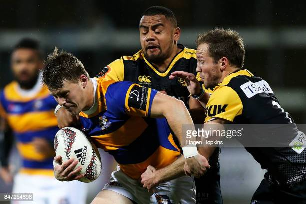 Luke Campbell of Bay of Plenty is tackled by Toa Halifihi and Marty McKenzie of Taranaki during the round five Mitre 10 Cup match between Taranaki...