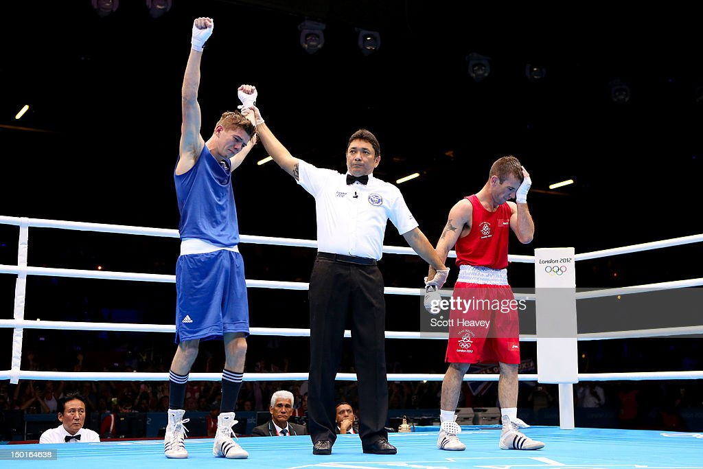 Luke Campbell (L) of Great Britain celebrates defeating John Joe Nevin (R) of Ireland to win the Men's Bantam (56kg) Boxing final bout on Day 15 of the London 2012 Olympic Games at ExCeL on August 11, 2012 in London, England.
