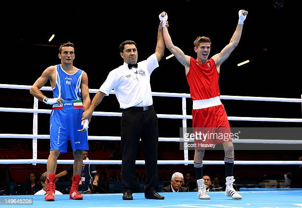 Luke Campbell of Great Britain celebrates his victory over Jahyn Vittorio Parrinello of Italy during the Men's Bantam Boxing on Day 5 of the London...
