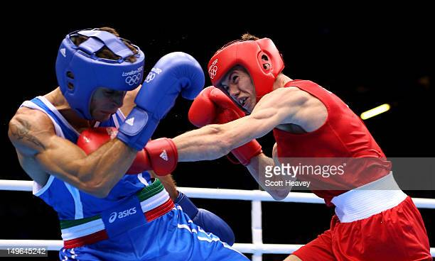 Luke Campbell of Great Britain in action with Jahyn Vittorio Parrinello of Italy during the Men's Bantam Boxing on Day 5 of the London 2012 Olympic...