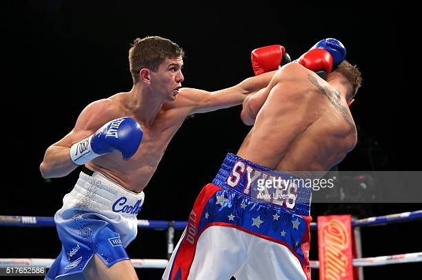 Luke Campbell throws a left shot at Gary Sykes during the Vacant Commonwealth Lightweight Championship fight between Luke Campbell and Gary Sykes at...