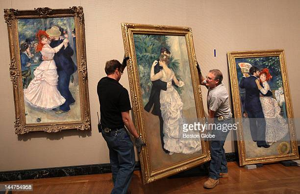 Luke Cannon left and Bill Wetterhahn right MFA crew members hung PierreAuguste Renoir's painting Dance in the City on loan from the Musee d'Orsay in...