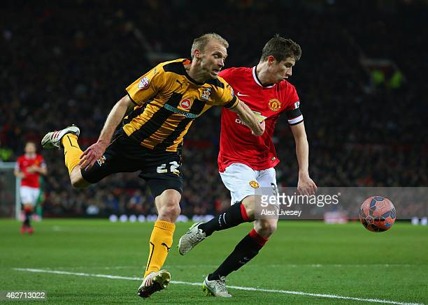 Luke Chadwick of Cambridge United and Paddy McNair of Manchester United battle for the ball during the FA Cup Fourth round replay match between...