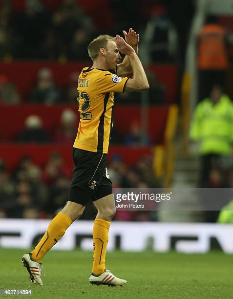 Luke Chadwick of Cambridge United applauds the fans after being substituted during the FA Cup Fourth Round replay between Manchester United and...