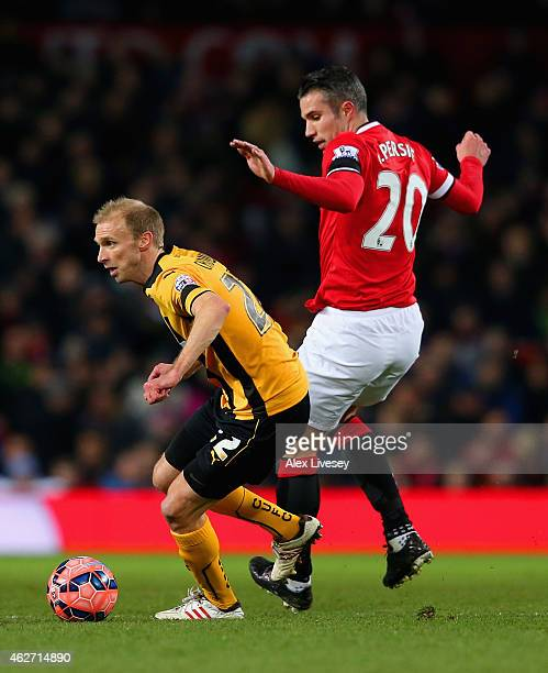 Luke Chadwick of Cambridge United breaks away from Robin van Persie of Manchester United during the FA Cup Fourth round replay match between...