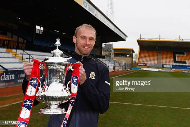 Luke Chadwick of Cambridge United holds the FA Cup trophy at the Abbey Stadium on January 19 2015 in Cambridge Cambridgeshire