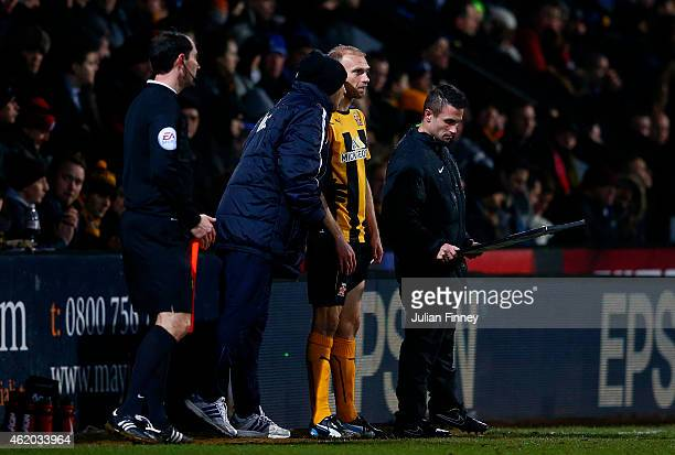 Luke Chadwick of Cambridge United prepares to come on as a substitute during the FA Cup Fourth Round match between Cambridge United and Manchester...