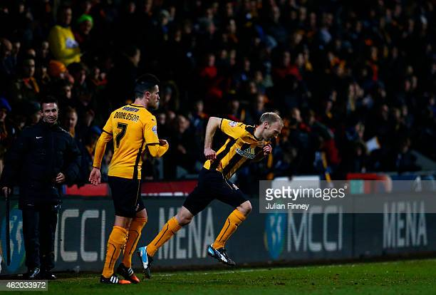 Luke Chadwick of Cambridge United runs on to the pitch as a substitute during the FA Cup Fourth Round match between Cambridge United and Manchester...