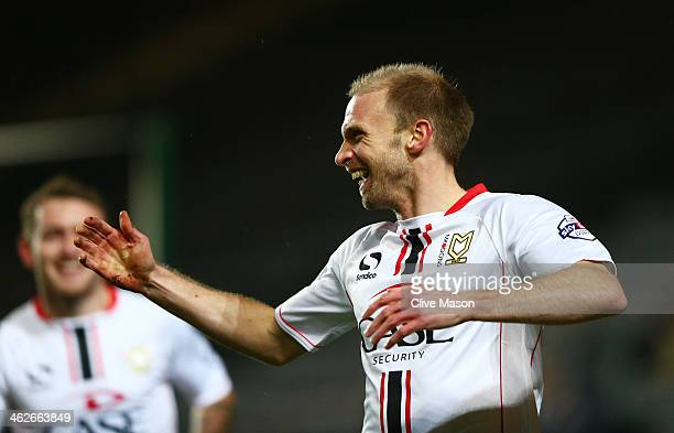 Luke Chadwick of Milton Keynes celebrates after scoring the opening goal during the Budweiser FA Cup third round replay match between Milton Keynes...