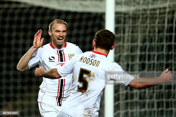 Luke Chadwick of Milton Keynes celebrates with teammate Lee Hodson after scoring the opening goal during the Budweiser FA Cup third round replay...