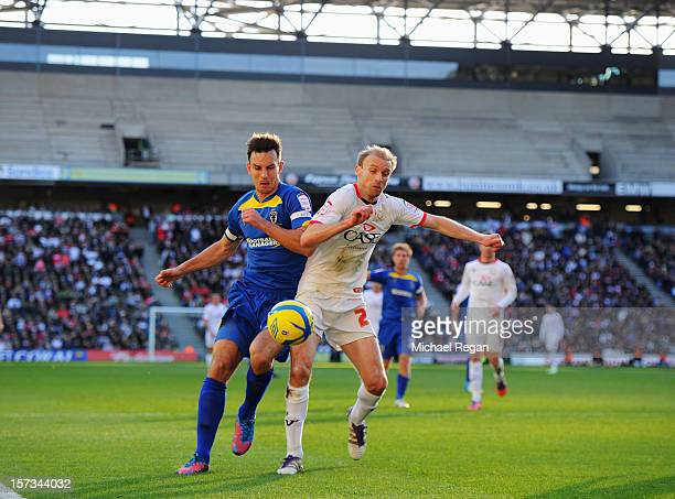 Luke Chadwick of MK Dons battles with Steve Gregory of AFC Wimbledon during the FA Cup with Budweiser Second Round match between MK Dons and AFC...