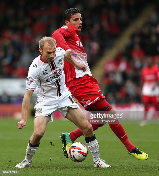 Luke Chadwick of MK Dons holds off Mathieu Baudry of Orient during the Sky Bet League One match between Leyton Orient and MK Dons at The Matchroom...