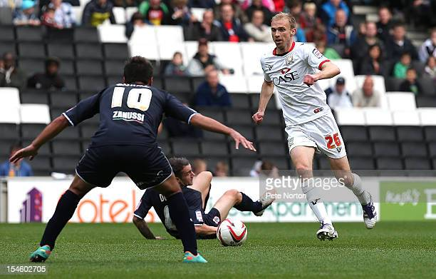 Luke Chadwick of MK Dons moves forward with the ball watched by Filipe Morais of Stevenage during the npower League One match between MK Dons and...