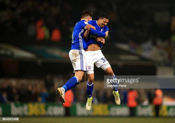 Luke Chambers and Myles Kenlock of Ipswich Town celebrate victory during the Sky Bet Championship match between Ipswich Town and Leeds United at...