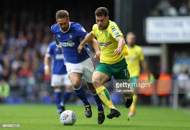 Luke Chambers of Ipswich and Yanic Wildschut of Norwich City battle for possession during the Sky Bet Championship match between Ipswich Town and...