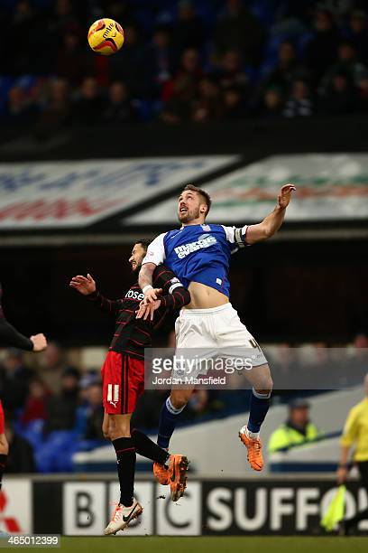 Luke Chambers of Ipswich Town and Jobi McAnuff of Reading battle in the air for the ball during the Sky Bet Championship match between Ipswich Town...