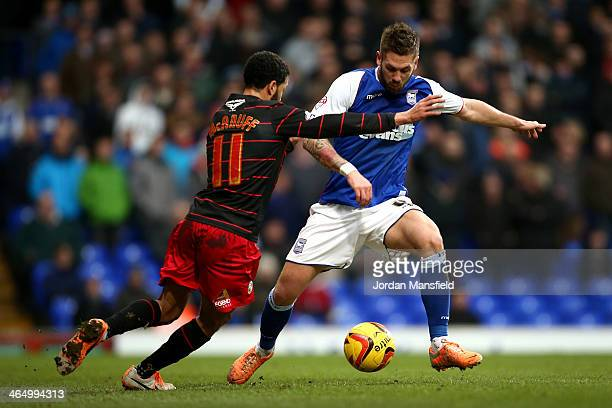 Luke Chambers of Ipswich Town takes the ball past Jobi McAnuff of Reading FC during the Sky Bet Championship match between Ipswich Town and Reading...